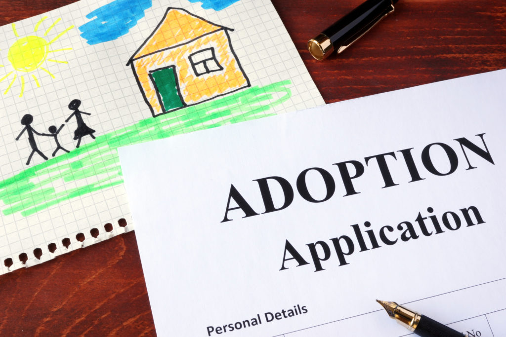 Citizenship can be gained through adoption.