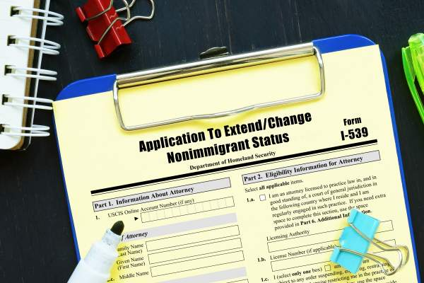 clipboard with form i-539 application to extend change nonimmigrant status